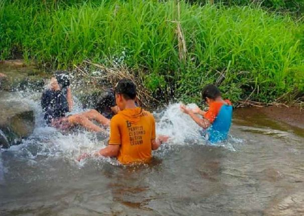 Children risking their lives at ponds and streams in Kharghar